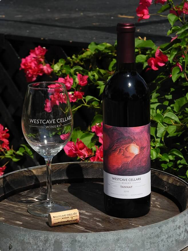 A small display of the Westcave Cellars Winery wine glass and wine
