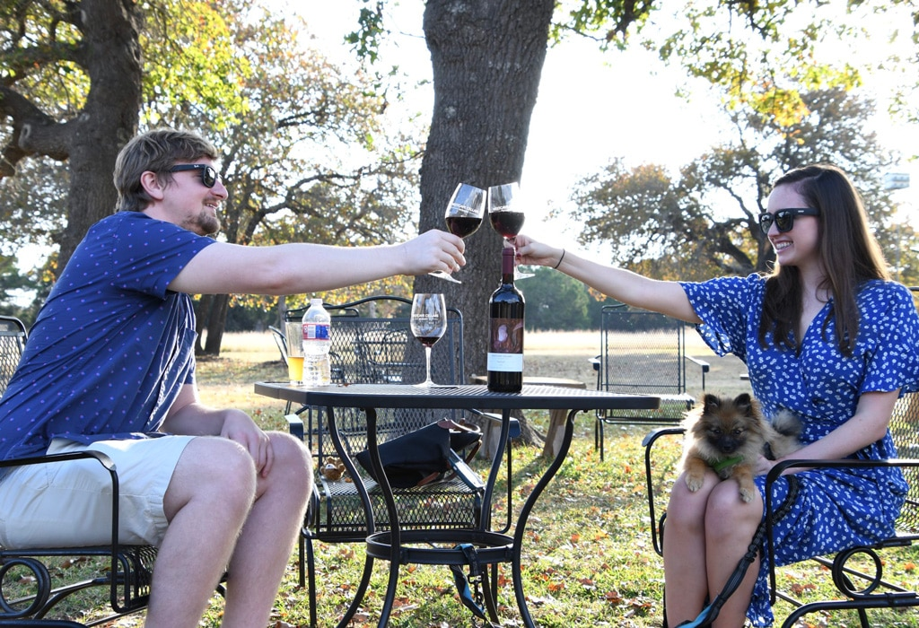 two people enjoying wine at Westcave Cellars Winery & Brewery